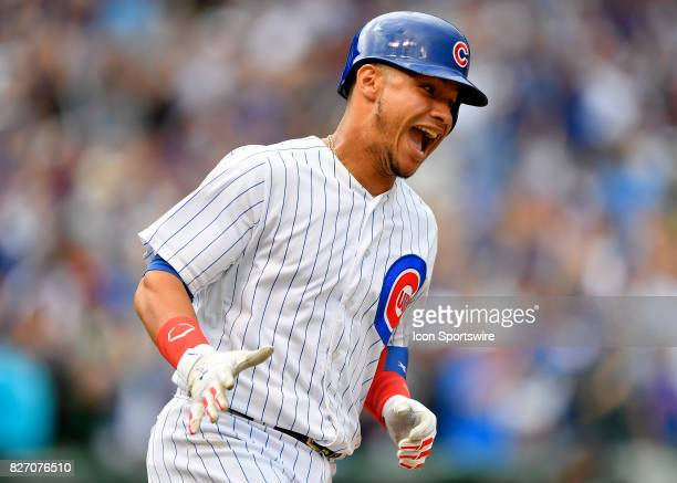 Chicago Cubs catcher Willson Contreras reacts after hitting a home run during the game between the Washington Nationals and the Chicago Cubs on...