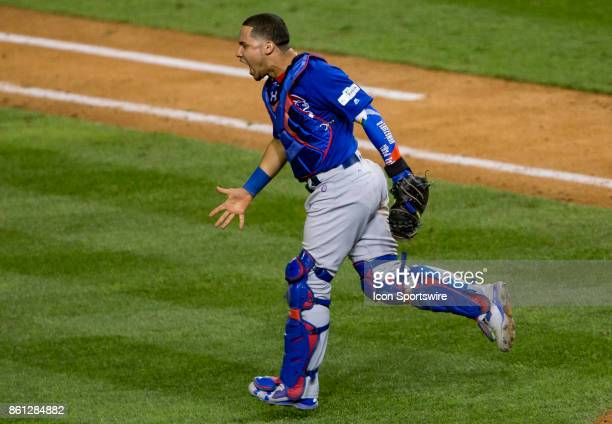 Chicago Cubs catcher Willson Contreras rejoices at the end of game five of the NLDS between the Washington Nationals and the Chicago Cubs on October...
