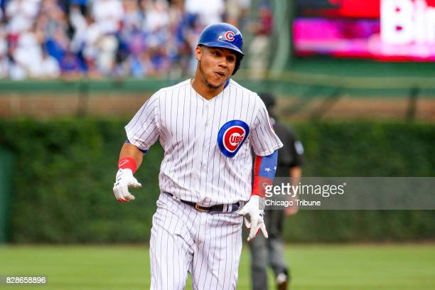 Chicago Cubs catcher Willson Contreras runs to third base after hitting a home run against the Washington Nationals on August 6 at Wrigley Field in...