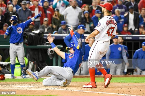 Chicago Cubs catcher Willson Contreras scores on a wild pitch from Washington Nationals starting pitcher Gio Gonzalez in the third inning during game...