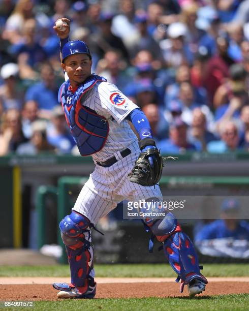 Chicago Cubs catcher Willson Contreras throws the ball to first base during a game between the Cincinnati Reds and the Chicago Cubs on May 18 at...