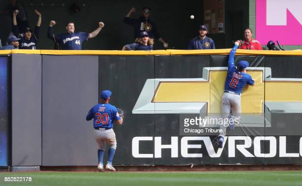 Chicago Cubs center fielder Ian Happ is unable to catch the gamewinning tworun home run ball hit by Milwaukee Brewers batter Travis Shaw in the 10th...
