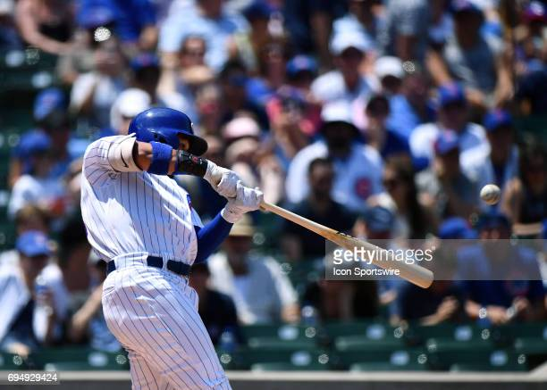 Chicago Cubs center fielder Jon Jay hits the ball for a single during the game between the Colorado Rockies and the Chicago Cubs on June 11 2017 at...