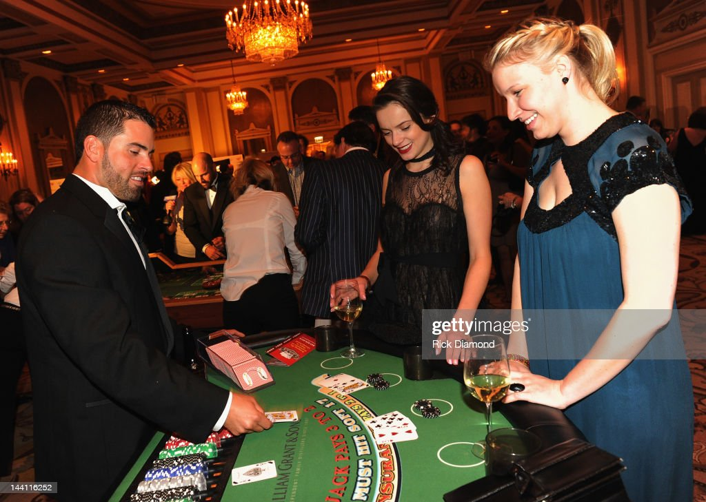 Chicago Cubs <a gi-track='captionPersonalityLinkClicked' href=/galleries/search?phrase=David+DeJesus&family=editorial&specificpeople=206765 ng-click='$event.stopPropagation()'>David DeJesus</a> deals Blackjack during the 2012 Dempster Foundation casino night at Palmer House Hotel on May 9, 2012 in Chicago, Illinois.