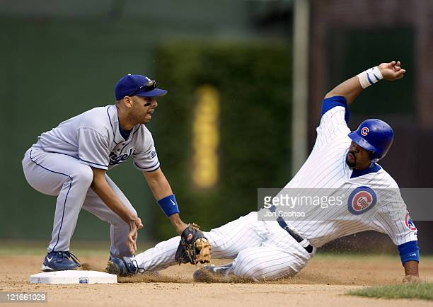 Chicago Cubs Derrek Lee right slides safely to second base as Los Angeles Dodgers Alex Cora drops the ball in the fifth inning Friday August 13 2004...