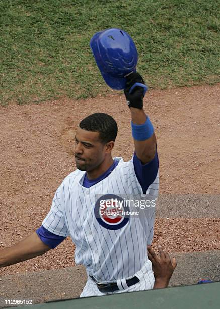 Chicago Cubs' Derrek Lee tips his cap after his pinchhit grand slam in the eighth inning against the Chicago White Sox at Wrigley Field in Chicago...