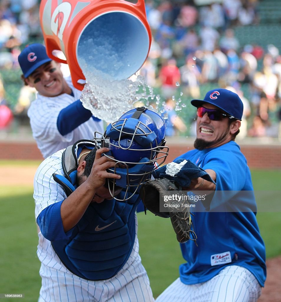 Chicago Cubs Dioner Navarro, center, gets an ice water shower and shaving cream pie in the face from Anthony Rizzo, back, and Matt Garza, right, on Wednesday, May 29, 2013, in Chicago, Illinois.