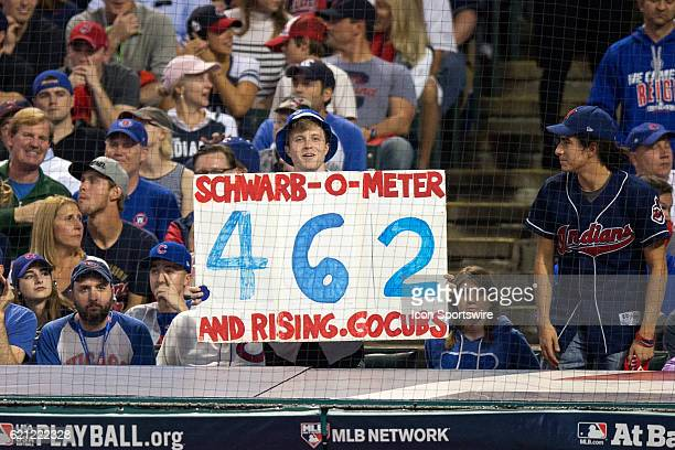 Chicago Cubs fan holds up a sign during the third inning of the 2016 World Series Game 7 between the Chicago Cubs and Cleveland Indians on November...