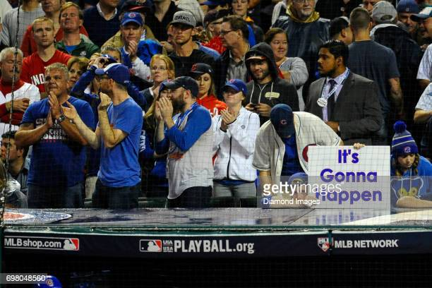 Chicago Cubs fan holds up a sign from behind home plate in the tenth inning of Game 7 of the World Series against the Cleveland Indians on November 2...