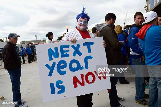 Chicago Cubs fan Mike Lyp holds a sign prior to game four of the National League Division Series between the Chicago Cubs and the St Louis Cardinals...