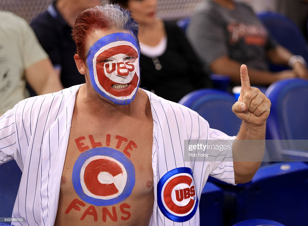 A Chicago Cubs fan poses for a photo during the game against the Miami Marlins at Marlins Park on June 26, 2016 in Miami, Florida.