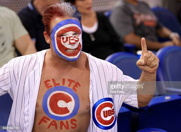 Chicago Cubs fan poses for a photo during the game against the Miami Marlins at Marlins Park on June 26 2016 in Miami Florida
