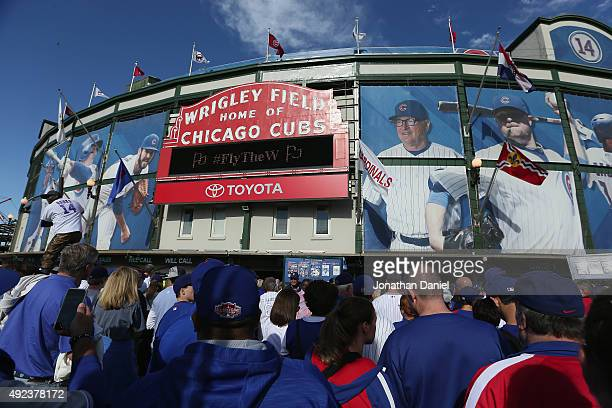 Chicago Cubs fans are seen outside of Wrigley Field prior to game three of the National League Division Series between the Chicago Cubs and the St...