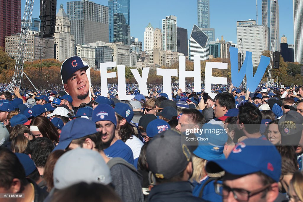 Chicago Cubs fans attend a rally in Grant Park to celebrate the team's World Series victory on November 4, 2016 in Chicago, Illinois. Hundreds of thousand of people lined the streets in downtown Chicago as the team paraded by in double deck buses on the way to the rally.
