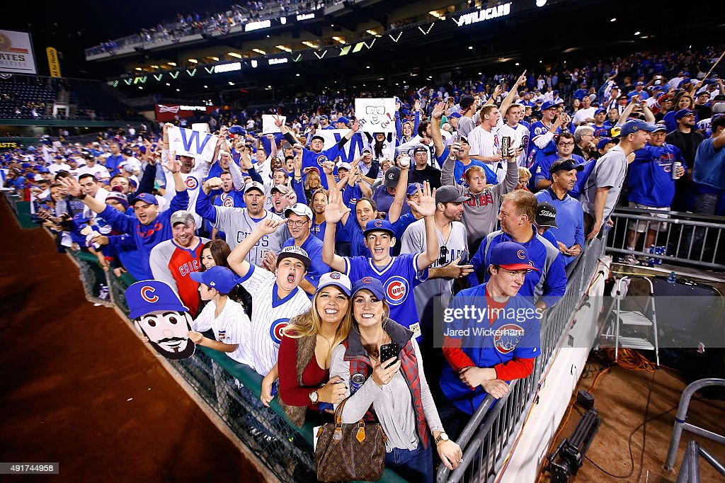 Chicago Cubs fans celebrate after the Chicago Cubs defeat the Pittsburgh Pirates to win the National League Wild Card game at PNC Park on October 7, 2015 in Pittsburgh, Pennsylvania. The Chicago Cubs defeated the Pittsburgh Pirates with a score of 4 to 0.