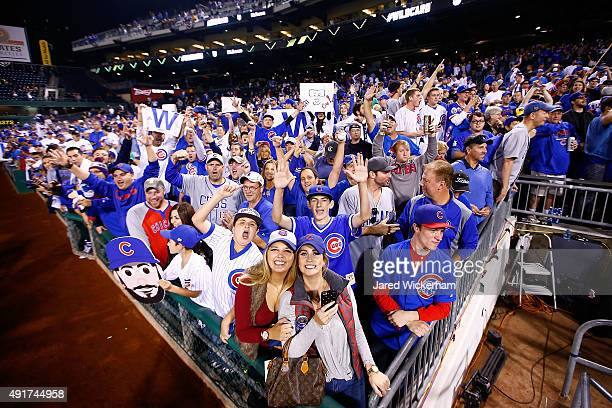 Chicago Cubs fans celebrate after the Chicago Cubs defeat the Pittsburgh Pirates to win the National League Wild Card game at PNC Park on October 7...