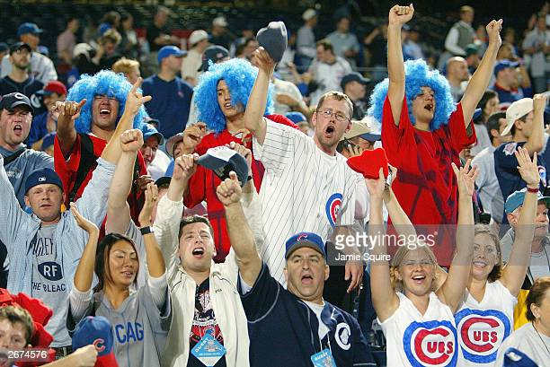 Chicago Cubs fans celebrate after the victory over the Atlanta Braves in Game 5 of the National League Division Series on October 5 2003 at Turner...