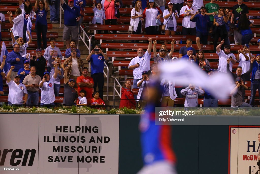 Chicago Cubs fans celebrate after winning the National League Central title against the St. Louis Cardinals at Busch Stadium on September 27, 2017 in St. Louis, Missouri.