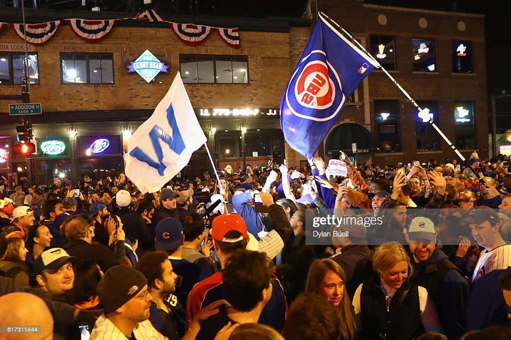 Chicago Cubs fans celebrate outside of Wrigley Field after the Chicago Cubs defeated the Los Angeles Dodgers 5-0 in game six of the National League Championship Series to advance to the World Series against the Cleveland Indians on October 22, 2016 in Chicago, Illinois.