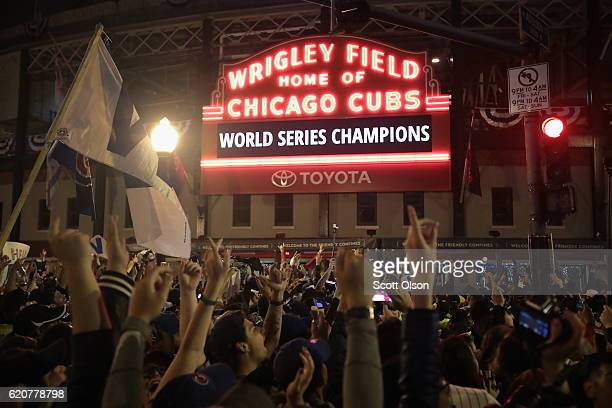 Chicago Cubs fans celebrate outside Wrigley Field after the Cubs defeated the Cleveland Indians in game seven of the 2016 World Series on November 2...