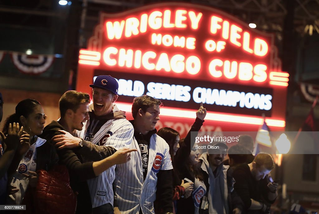 Chicago Cubs fans celebrate outside Wrigley Field after the Cubs defeated the Cleveland Indians in game seven of the 2016 World Series on November 2, 2016 in Chicago, Illinois. The Cubs 8-7 victory landed them their first World Series title since 1908.