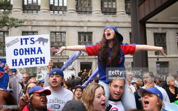 Chicago Cubs' fans celebrate the team making it into the playoff at a lunchtime rally downtown October 1 2007 in Chicago Illinois This is the first...