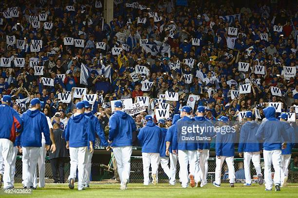 Chicago Cubs fans cheer after the Chicago Cubs defeat the St Louis Cardinals 8 to 6 in game three of the National League Division Series at Wrigley...