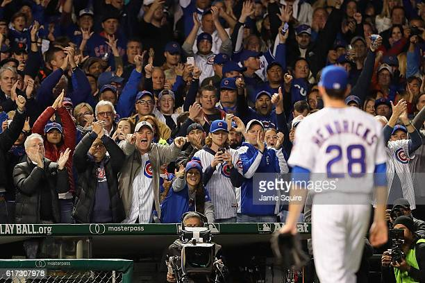 Chicago Cubs fans cheer as Kyle Hendricks of the Chicago Cubs is relieved in the eighth inning during game six of the National League Championship...