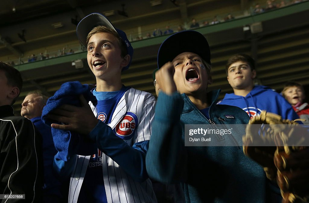 Chicago Cubs fans cheer during the game against the San Francisco Giants at Wrigley Field on October 7 2016 in Chicago Illinois