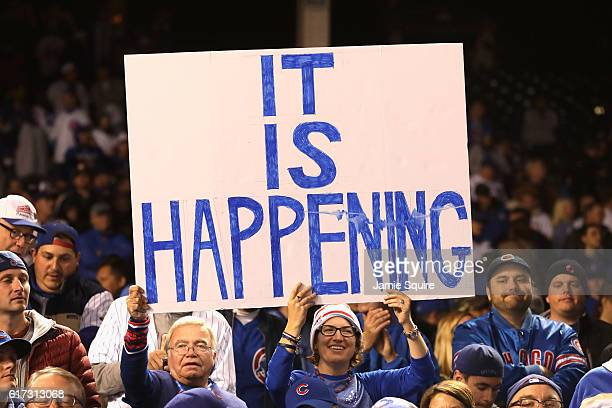 Chicago Cubs fans hold a sign after the Chicago Cubs defeated the Los Angeles Dodgers 50 in game six of the National League Championship Series to...