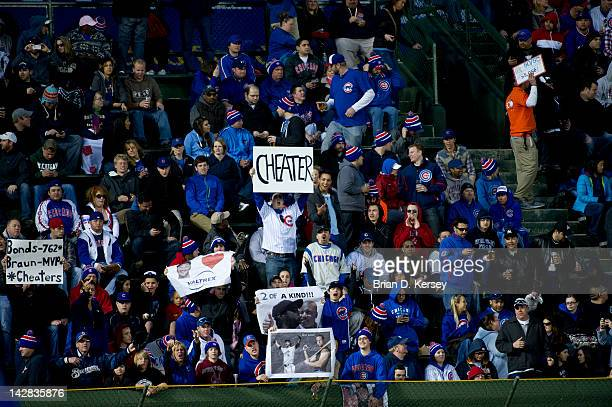 Chicago Cubs fans hold up signs to taunt left fielder Ryan Braun of the Milwaukee Brewers at Wrigley Field on April 9 2012 in Chicago Illinois
