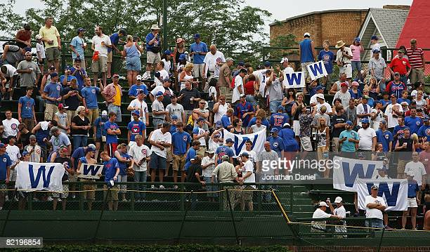 Chicago Cubs fans hold W flags in the left field bleachers after a Cubs victory over the Houston Astros on August 6 2008 at Wrigley Field in Chicago...