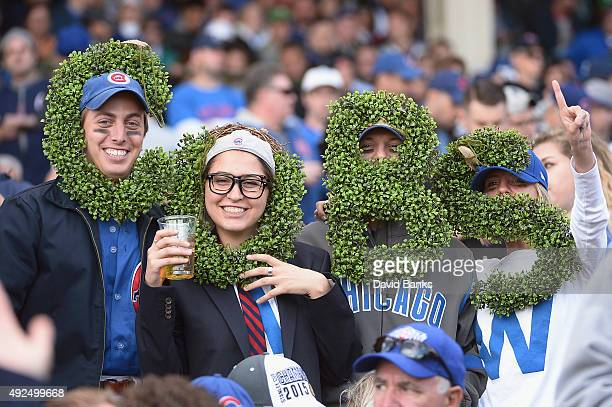 Chicago Cubs fans pose for a picture in the second inning during game four of the National League Division Series between the Chicago Cubs and the St...