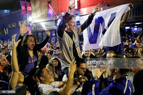 Chicago Cubs fans take to the streets to celebrate the Cubs win in the National League Wild Card Game against the Pittsburgh Pirates on October 7...