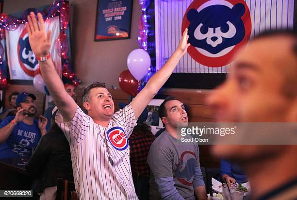 Chicago Cubs fans watch the Chicago Cubs play the Cleveland Indians during game seven of the 2016 World Series at The Stretch bar in the Wrigleyville...
