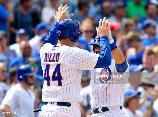 Chicago Cubs first baseman Anthony Rizzo and Chicago Cubs catcher Alex Avila celebrate at home plate during the game between the Cincinnati Reds and...