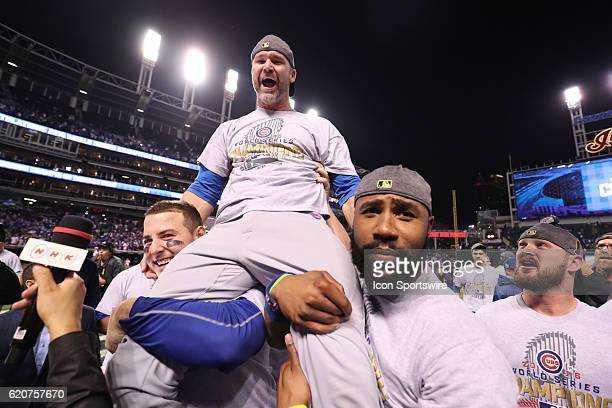 Chicago Cubs first baseman Anthony Rizzo and Chicago Cubs right fielder Jason Heyward hold up teammate David Ross after winning game 7 of the 2016...