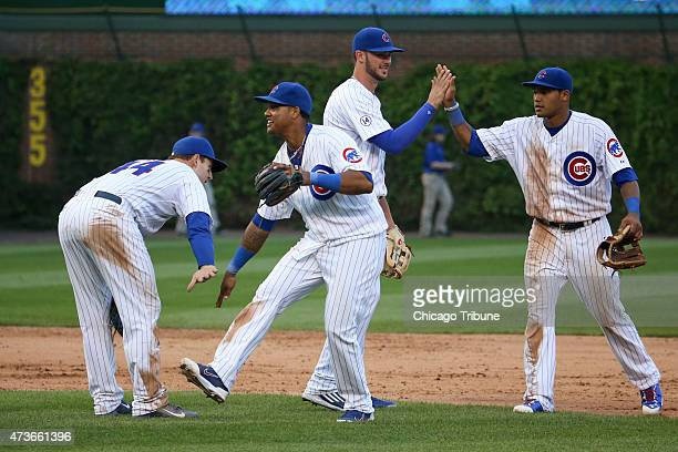 Chicago Cubs first baseman Anthony Rizzo from left shortstop Starlin Castro third baseman Kris Bryant and second baseman Addison Russell celebrate...