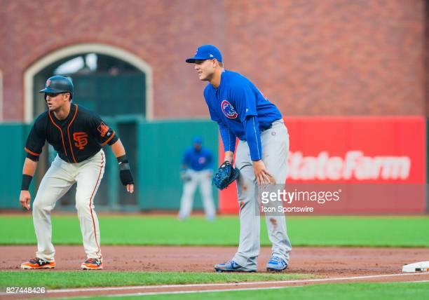 Chicago Cubs first baseman Anthony Rizzo keeps a close eye on San Francisco Giants second baseman Joe Panik during the regular season game between...