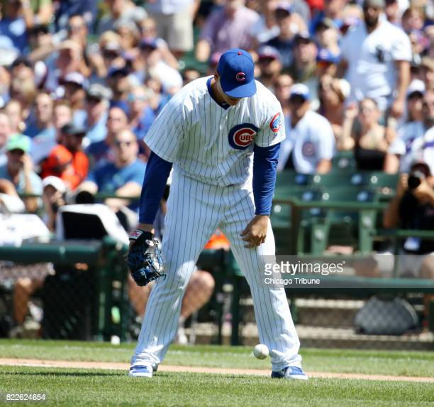Chicago Cubs first baseman Anthony Rizzo lets a pop up drop for an infield fly rule in the fourth inning during action against the Chicago White Sox...