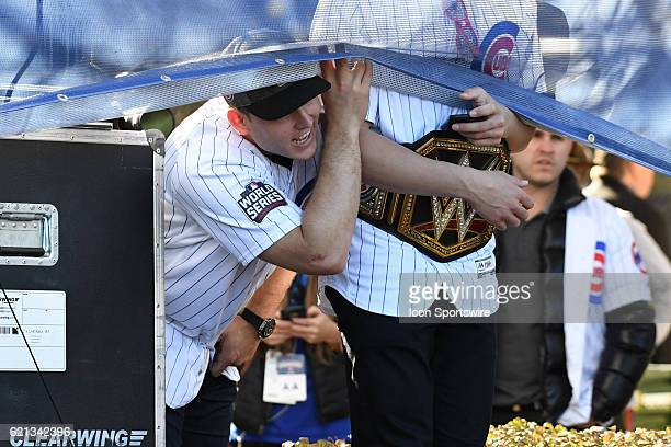 Chicago Cubs first baseman Anthony Rizzo peaks under a banner next to Chicago Cubs third baseman Kris Bryant during the Chicago Cubs World Series...