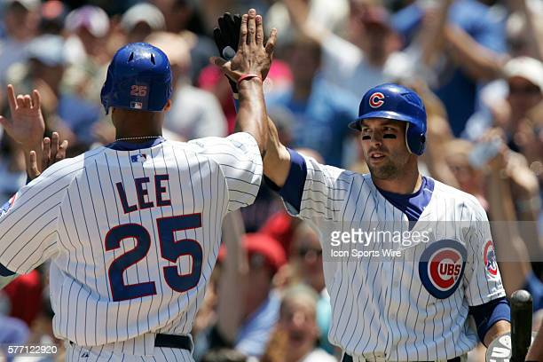 Chicago Cubs first baseman Derrek Lee is congratulated at home by shortstop Ryan Theriot The Chicago Cubs defeated the Milwaukee Brewers 51 at...
