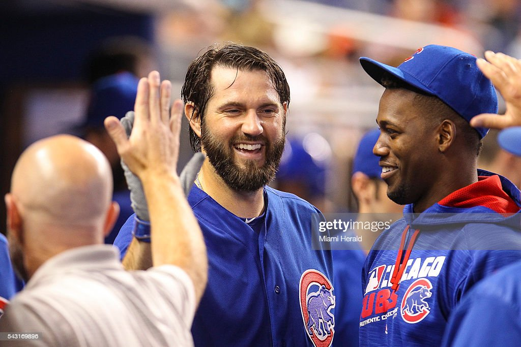 Chicago Cubs' Jason Hammel (39) celebrates with his teammates after scoring during the third inning on Sunday, June 26, 2016, at Marlins Park in Miami.