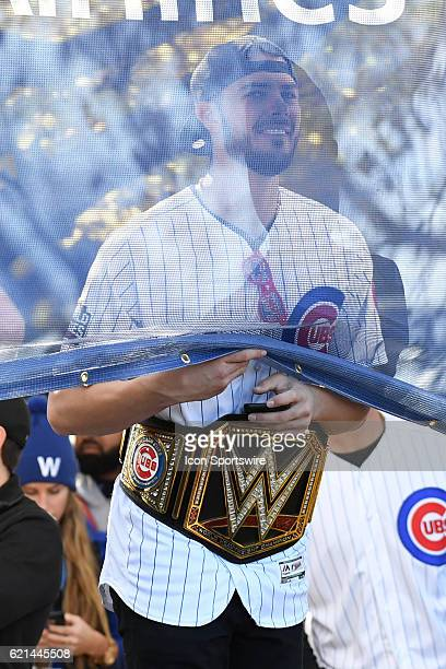 Chicago Cubs Kris Bryant peaks through a banner during the Chicago Cubs World Series victory rally on November 4 at Grant Park in Chicago IL