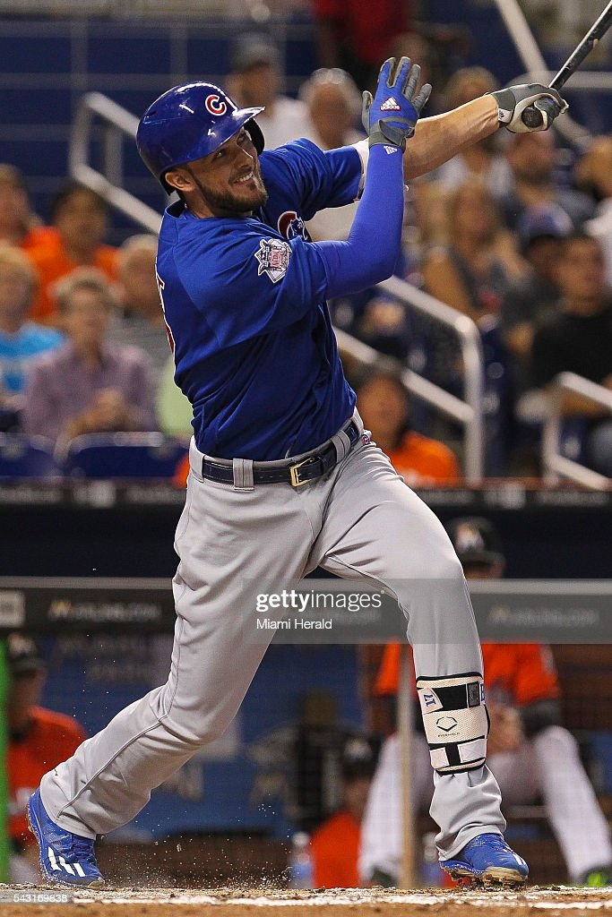 Chicago Cubs' Kris Bryant (17) sacrifices a fly to center during the third inning on Sunday, June 26, 2016, at Marlins Park in Miami.
