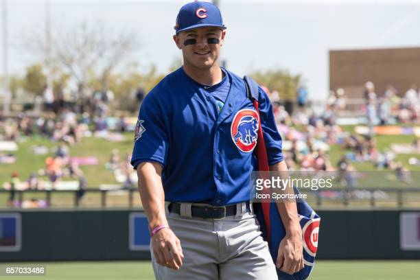 Chicago Cubs left fielder John Andreoli enters the dugout before the spring training baseball game between the Chicago Cubs and the Colorado Rockies...