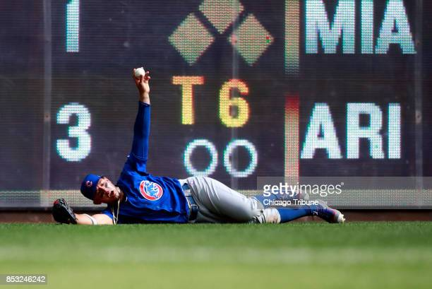 Chicago Cubs left fielder Jon Jay after catching a fly out by the Milwaukee Brewers' Jesus Aguilar during the fourth inning at Miller Park in...