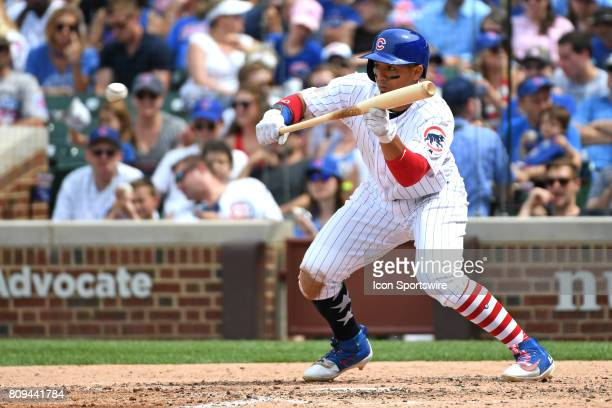 Chicago Cubs left fielder Jon Jay bunts for a single in the fifth inning during a game between the Tampa Bay Rays and the Chicago Cubs on July 4 at...