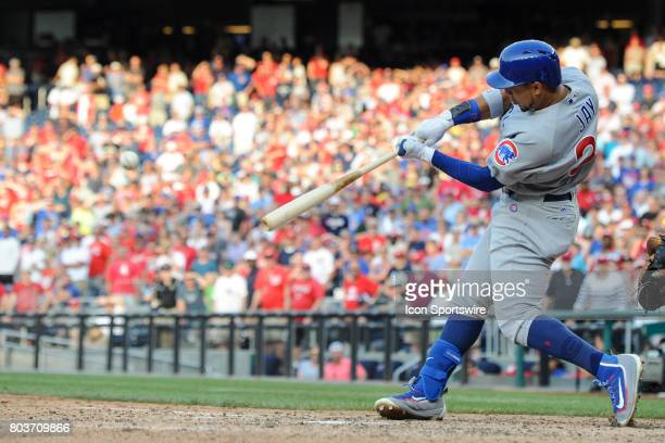 Chicago Cubs left fielder Jon Jay doubles in the winning run in the ninth inning during an MLB game between the Chicago Cubs and the Washington...