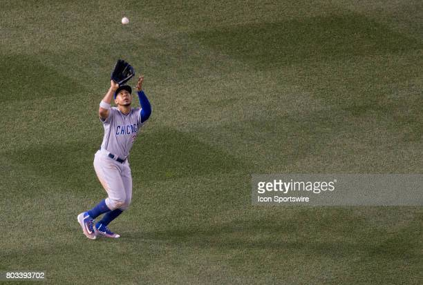 Chicago Cubs left fielder Jon Jay makes the play during a MLB game between the Washington Nationals and the Chicago Cubs on June 28 at Nationals Park...